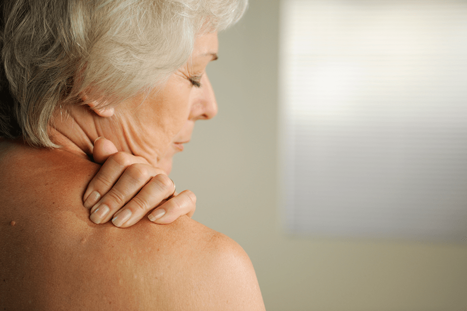 Woman with painful shoulder
